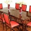 Eßtisch und Stühle aus Vollholz gefertigt und mit Makassarebenholz furniert, hochglänzend lackiert
